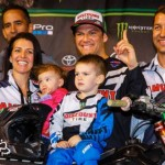 Chad Reed and his family enjoy the winner's circle after round three of the Monster Energy AMA Supercross season at Angel Stadium. (Kawasaki photo)