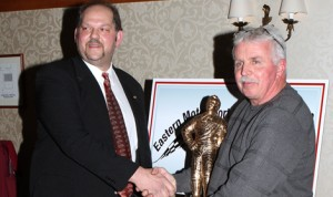 Fred Rahmer (right) receives the first of two awards during the annual Eastern Motorsports Press Ass'n convention on Saturday. (EMPA Photo)