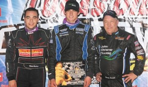 Caleb Armstrong (center) won Wednesday's Chili Bowl Nationals preliminary feature. He's joined by runner-up Sammy Swindell (right) and third-place Chris Windom. (Frank Smith photo)