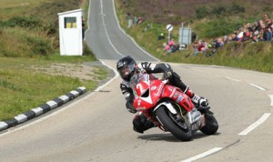 Connor Behan sweeping through Creg-ny-baa during the 2013 Manx Grand Prix Newcomers Race