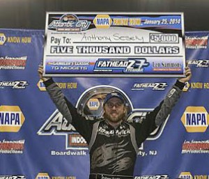 Anthony Sesley celebrates after sweeping the Gambler's Classic indoor three-quarter midget events at Boardwalk Hall in Atlantic City, N.J., on Saturday. (Bob Yuko Photo)