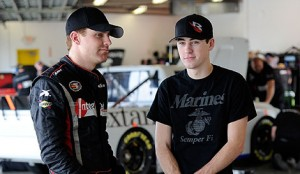 Jimmy Weller(L), driver of the #07 Green Light Racing, speaks with Ryan Blaney, driver of the #19 Cooper Standard Ford, during NASCAR Preseason Thunder at Daytona International Speedway on January 13, 2014 in Daytona Beach, Florida.  (Photo by Jared C. Tilton/NASCAR via Getty Images)