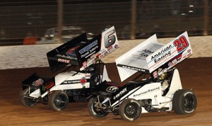 Kerry Madsen (29) battles Bill Rose during the World of Outlaws World Finals at The Dirt Track at Charlotte. (Dick Ayers photo)