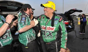 John Force celebrates with his crew after winning the Funny Car portion of the Circle K NHRA Winternationals on Sunday in Pomona, Calif. (NHRA Photo)