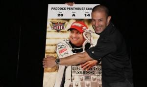 Tony Kanaan jokingly hugs his likeness, which will appear on the 2014 Indianapolis 500 ticket. (IMS Photo)