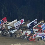 Dave Blaney (98h), Dale Blaney (14k), Kerry Madsen (29) and Steve Buckwalter lead the UNOH All Star Circuit of Champions field in a four-wide salute prior to the start of Sunday's feature at Bubba Raceway Park in Ocala, Fla. (Chris Seelman Photo)