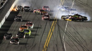 Denny Hamlin (11) leads the field to the checkered flag as a crash happens behind him during the second Budweiser Duel Thursday at Daytona Int'l Speedway. (HHP/Tom Copeland Photo)