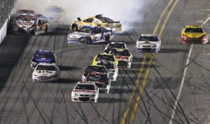 Dale Earnhardt Jr. leads the field to the checkered flag as cars crash behind him. (HHP/Tom Copeland Photo)