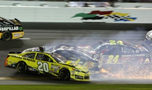 Matt Kenseth (20) crashes with Tony Stewart (14) and Jeff Gordon during the Sprint Unlimited. (HHP/Christa L. Thomas Photo)