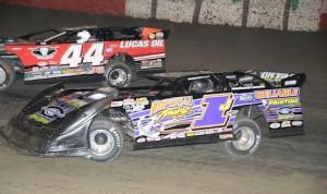 Davey Johnson races under Earl Pearson Jr. (44) Saturday night at East Bay Raceway Park. (Al Steinberg photo)