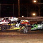 Battling it out three wide during the DIRTcar UMP Modified feature at Volusia Speedway Park are Jeffrey Lien Jr (24), Cody Bauman (4), and Troy Girolamo (2G). (Hein Brothers Photo)