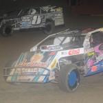 Jason Gross (12) and Matt Miller during Monday's modified feature at East Bay Raceway Park. (Al Steinberg Photo)