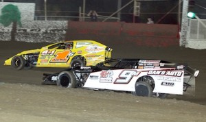 Dale Mathison (9) grabs the lead from Devin Gilpin Tuesday night at East Bay Raceway Park. (Mike Horne photo)