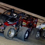 Casey Shuman (21) leads a line of cars during Thursday's AMSOIL USAC National Sprint Car Series race at Bubba Raceway Park in Florida. (Chris Seelman Photo)