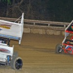 Jac Haudenschild (9w) leads Dave Blaney during the UNOH All Star Circuit of Champions feature Monday at Bubba Raceway Park in Florida. (Chris Seelman Photo)