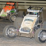 Justin Grant (40) races eventual event winner Brady Bacon during Thursday's AMSOIL USAC National Sprint Car Series feature at Bubba Raceway Park in Ocala, Fla. (Al Steinberg Photo)