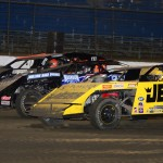 Kenny Wallace (36), Kyle Bronson (40) and Billy Workman Jr. race three wide in front of the grandstands on Tuesday at East Bay Raceway Park. (Joe Secka/JMS Pro Photo)