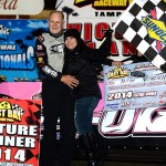 Keith Nosbisch (02) and Mimi are all smiles after he won the Crate Late Model feature at East Bay Saturday night. (Photo: Joe Secka / JMS ProPhoto)