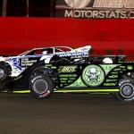 Scott Bloomquist (0) races alongside Jared Landers during Tuesday's Lucas Oil Late Model Dirt Series feature at East Bay Raceway Park. (Joe Secka/JMS Pro Photo)