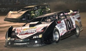 Eventual WoO LM winner Casey Roberts races under Scott Bloomquist (0) Thursday night at Volusia Speedway Park. (R.E. Wing photo)