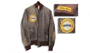 The brown leather jacket is fully lined and features a yellow club applique embroidered with Shaw's name.