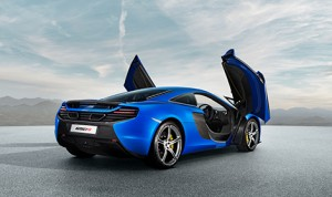 Unique side intakes behind the dihedral doors feed large, efficiently packaged, radiators which help provide the cooling requirements of the mid-mounted, compact engine. (Photo: McLaren Automotive)