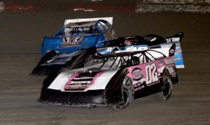 Keith Nosbisch (02) goes three-wide to take the lead en route to victory in Saturday's crate late model feature at East Bay Raceway Park. (Mike Horne Photo)