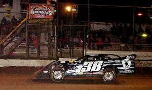 Blasting under the double checkered flags, Kenny Pettyjohn nabs Wednesday's DIRTcar UMP Late Model A-Main at Volusia Speedway Park. (Photo: Hein Brothers)