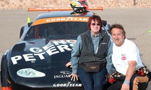 Michael Lewis posed with Lois Peterson, Gene Peterson's widow, in front of his race-winning memorial to Gene. (Photo: Jean Willis Munn)