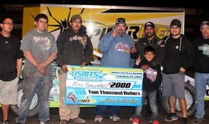 Fito Gallardo stands in victory lane with his family and crew after winning his first United States Modified Touring Series event at Southern New Mexico Speedway Thursday. (Donald Iverson Photo)