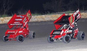Jon Agan (4) battles Kevin Ramey en route to victory Friday night at Golden Triangle Raceway Park. (RonSkinnerPhotos.com photo)