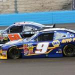 Chase Elliott (9) works under Chris Buescher during Saturday's NASCAR Nationwide Series race at Phoenix Int'l Raceway. (HHP/Christa L. Thomas Photo)