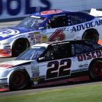 Brad Keselowski (22) works under Trevor Bayne during Saturday's NASCAR Nationwide Series race at Las Vegas Motor Speedway. (HHP/Rusty Jarrett Photo)