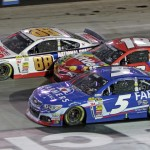 Kasey Kahne (5), Kyle Busch (18) and Dale Earnhardt Jr. battle three-wide during Sunday's Food City 500 at Bristol Motor Speedway. (HHP/Alan Marler Photo)