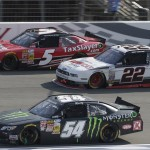 Kyle Busch (54), Joey Logano (22) and Kevin Harvick battle three-wide during Saturday's NASCAR Nationwide Series race at Auto Club Speedway. (HHP/Harold Hinson Photo)