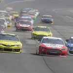 Matt Kenseth (20), Brad Keselowski (2) and Clint Bowyer (15) battle at the front of the pack during Sunday's NASCAR Sprint Cup Series event at Auto Club Speedway. (HHP/Harold Hinson Photo)