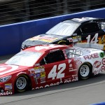 Kyle Larson (42) battles Tony Stewart during a NASCAR Sprint Cup Series race at Auto Club Speedway in Fontana, Calif. (HHP/Rusty Jarrett Photo)