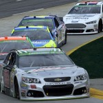 Dale Earnhardt Jr. (88) leads a pack of cars during Sunday's STP 500 at Martinsville (Va.) Speedway. (HHP/Harold Hinson Photo)