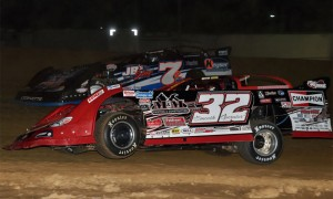 Bobby Pierce (32), seen here racing Kent Robinson at Brownstown Speedway earlier this year, won Thursday's Lucas Oil Late Model Dirt Series event at Macon (Ill.) Speedway. (Rick Schwallie Photo)