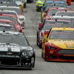 Jimmie Johnson (48) and Joey Logano (22) lead during an early restart Sunday at Bristol Motor Speedway. (Drew Hierwarter Photo)