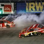 Kevin Harvick (4) goes up in smoke while Jamie McMurray (1) and Brad Keselowski make contact behind him during the Food City 500 Sunday at Bristol Motor Speedway. (NASCAR Photo)