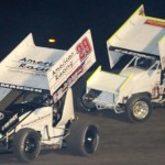 Kerry Madsen (29) and Bud Kaeding battle during Saturday's World of Outlaws STP Sprint Car Series feature at Stockton (Calif.) 99 Dirt Track. (Tom Parker Photo)