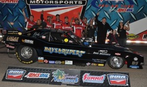 Jason Rupert and his Funny Car team celebrate winning Saturday's IHRA opener at Southwestern Int'l Raceway. (IHRA photo)