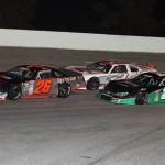 Preston Peltier (26), Jared Irvan (28) and Trevor Noles battle during Saturday's PASS South feature at Dillon (S.C.) Motor Speedway. (LWPictures.com Photo)