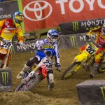 Andrew Short (29), Wil Hahn (23) and Broc Tickle (20) battle during the Monster Energy Supercross race at Lucas Oil Stadium in Indianapolis. (Photo: Shawn Mueller)