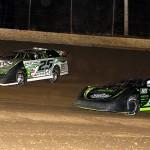 Scott Bloomquist (0) battles Jason Feger during Saturday's Thaw Brawl at LaSalle (Ill.) Speedway. (Mike Ruefer Photo)
