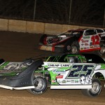Jason Feger (25) races under Kevin Weaver during Saturday's Thaw Brawl at LaSalle (Ill.) Speedway. (Mike Ruefer Photo)
