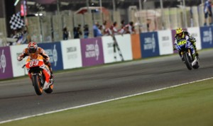 Marc Marquez (93) beats Valentino Rossi to the finish line to win Sunday's MotoGP opener in Qatar. (MotoGP Photo)