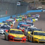 Brad Keselowski (2) and Joey Logano (22) lead the NASCAR Sprint Cup Series field at the start of Sunday's race at Phoenix Int'l Raceway. (NASCAR Photo)