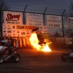 Danny Burke's midget catches fire mid-flip during the first heat race as part of Saturday's Lucas Oil POWRi National Midget Series opener at Port City Speedway. He was uninjured. (Boyd Adams Photo)